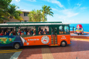 key west trolley driving past southernmost point buoy