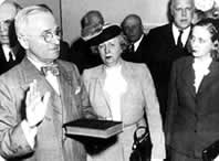 Harry S. Truman takes the oath of office on April 12, 1945.