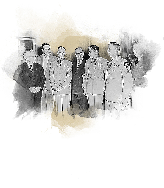 President Truman with officers while enacting civil rights executive order